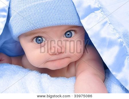 Little Boy Baby Laying Under Blue Blanket