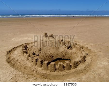 Sand Castle On The Ocean Beach