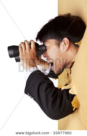 Shocked Businessman Looking With Binoculars