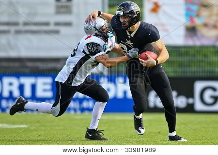 VIENNA, AUSTRIA - JUNE 11 QB Stefan Poster (#88 Rangers) is tackled by DB Andre Pescosta (#48 Raiders) on June 11, 2011 in Vienna, Austria. The Rangers beat the Swarco Raiders II 41:10.