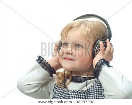 little child girl smiling isolated on white background with headphones