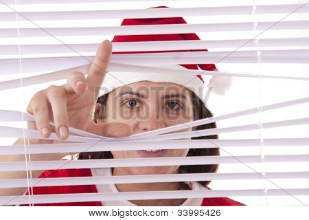 Mrs. Santa Claus hands apart on the window blinds