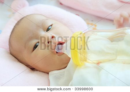 baby and drinking water bottle