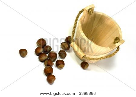 Hazelnuts And Empty Wooden Busket