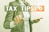 Conceptual Hand Writing Showing Tax Tips. Business Photo Showcasing Compulsory Contribution To State poster