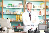 Portrait of an handsome pharmacist in his shop