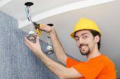 Electrician repairman working on refurbishment poster