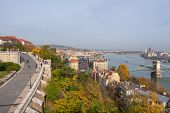 Panoramic Scenery Of Buda Castle Area With Tourists, Danube River, Parliament Building And City View poster