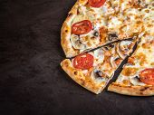 A Fragment Of Pizza With Mushrooms, Tomatoes, And Cheese Lies On A Dark Background. A Sliced Slice N poster