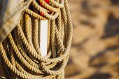 Rope On Boats Deck. Hanging Rope Wool Close-up On Blurred Background. Marine Rope. Ship Rope poster