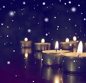Candles Lights On Dark Background. Light Of Candle Flame, Holiday Background.many Burning Candles. poster