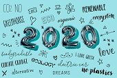 some silvery number-shaped balloons forming the number 2020, as the new year, and some new year reso poster