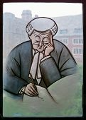picture of quadrangles  - A stained glass image of a lawyer or perhaps an English barrister deep in thought who is writing an entry into a journal - JPG