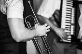 Trumpet In Musician Hands. Retro Stylized Black And White Photo, Live Music Background poster