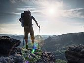 Hiker Hold Trekking Sticks For Nordic Walking And Deep Breath At The Edge. poster