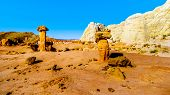 Toadstool Hoodoos Against The Background Of The Colorful Sandstone Mountains In Grand Staircase-esca poster