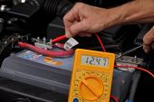 Battery Voltage Measurement With A Meter. Car Repair Shop. poster