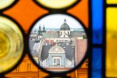 The Roofs Of Krakow S Old Town Through The Colored Stained Glass From The Town Hall Tower On A Summe poster