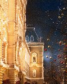 Night Photo Of Illumination And Decoration Of Gum Shop And Red Square During A Snowfall. Red And Gol poster