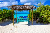 The View Of Empty Beach On Half Moon Cay Island At Bahamas. Blue Water And White Sand poster