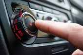 Button For Heating The Car Seats Close-up. The Male Hand Presses The Button For Heating The Seats Of poster