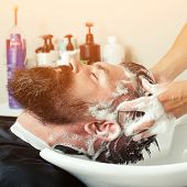 Hairstylist Hairdresser Washing Customer Hair - Brutal Man Relaxing In Hairdressing Beauty Salon. Ha poster