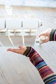 Radiator Adjustment Closeup. Female Hand Adjusting Radiator Temperature poster