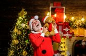 Happy Santa Claus With Teddy Bear. Bearded Man In Santa Claus Costume. Santa Claus Holds Plush Toy.  poster
