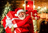 Christmas And New Year Concept. Bearded Man In Santa Hat Holds Christmas Present. Present Box. Santa poster