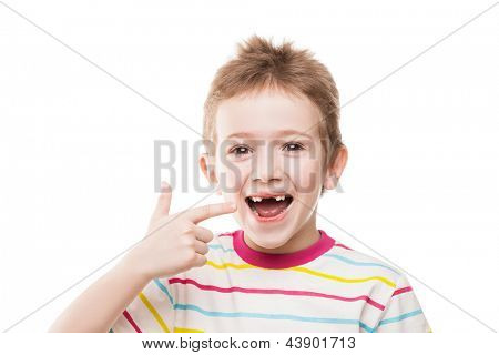 Little smiling child boy hand pointing his first baby milk or temporary teeth fall out