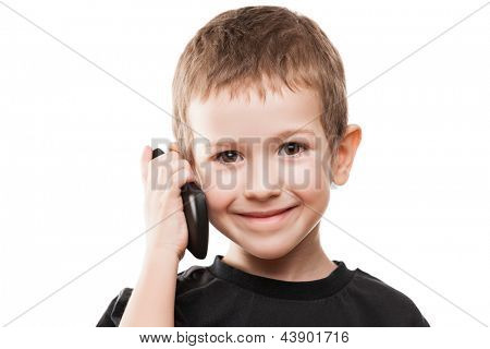 Little smiling child boy hand holding mobile phone or smartphone white isolated