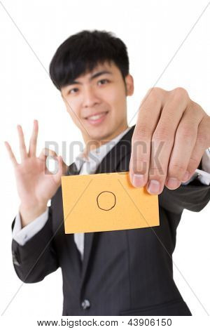 Asian businessman holding a card written on circle shape, closeup portrait.