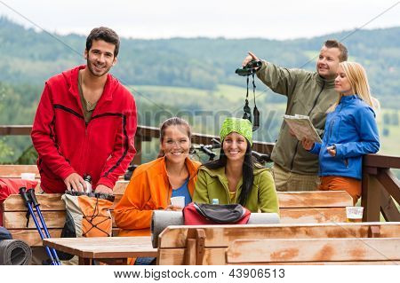 Young caucasian friends relaxing mountain countryside view summer sport