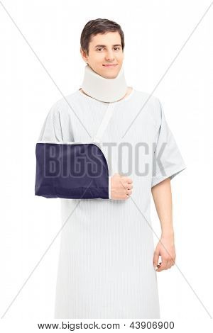 A male patient with a broken arm and neck posing isolated on white background