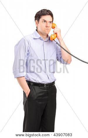 Angry man having a telephone conversation, isolated on white background