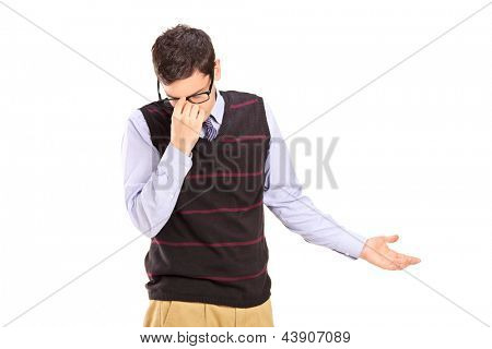 Upset young man holding his head isolated on white background