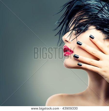Fashion Art Model Girl Portrait. Punk Style Woman. Black Hair and Nails.