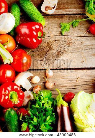 Healthy Organic Vegetables on a Wooden Background. Vertical Frame Design