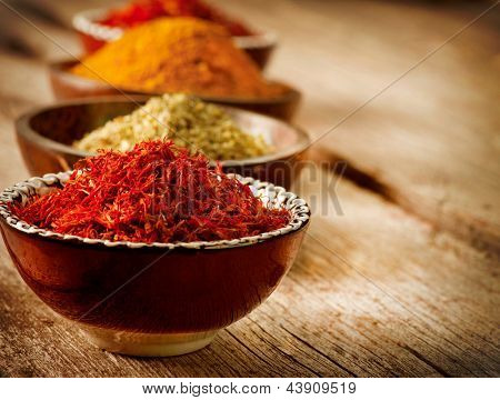 Spices Curry, Saffron, turmeric. Spice over Wood