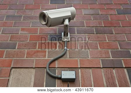 cctv security video camera  on outside wall of a building