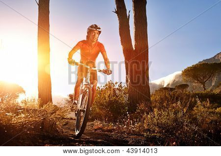 Mountain Bike cyclist riding single track at sunrise. healthy lifestyle mountainbike sport.