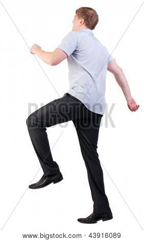 back view of walking  business man. Smiling office worker runs.  going guy in shirt. stylishly dressed man. Isolated over white background. Rear view people collection. backside view of person