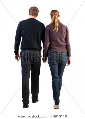 Back view of walking  young couple (man and woman). going beautiful friendly girl and guy in shorts together. Rear view people collection.  backside view of person.  Isolated over white background.