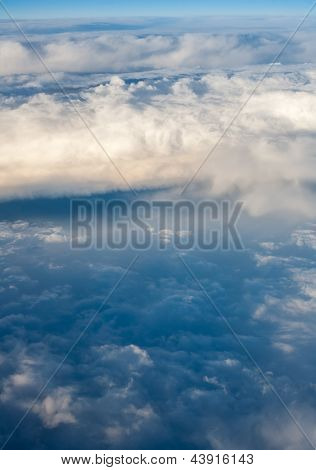 clouds. top view from the window of an airplane flying in the clouds. clouds are boiling above the clouds