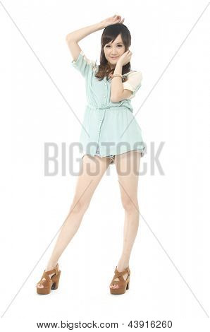 Full length of a happy young woman smiling against white background