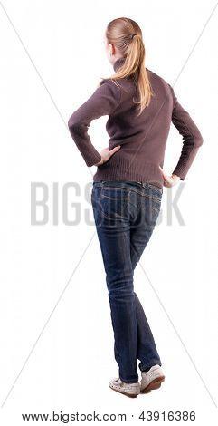 exibição permanente bela loira jovem de volta. menina assistindo. Coleção de pessoas de vista traseira. backsi
