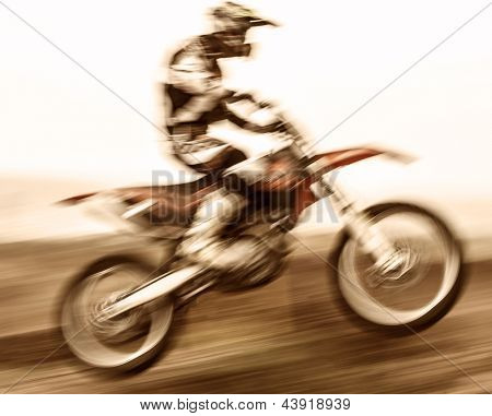 Extreme sport, slow motion on motorbike, pro race driver jumping on the dirt bike, motocross, speed and challenge concept