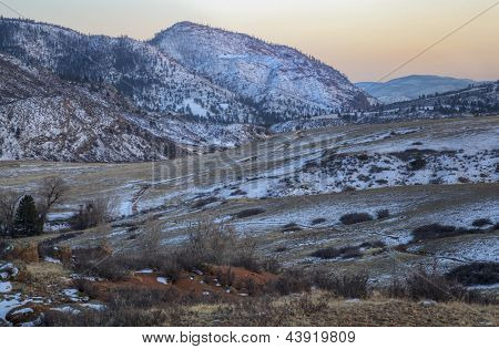 winter dusk at mountain valley of North Fork Cache la Poudre River in northern Colorado