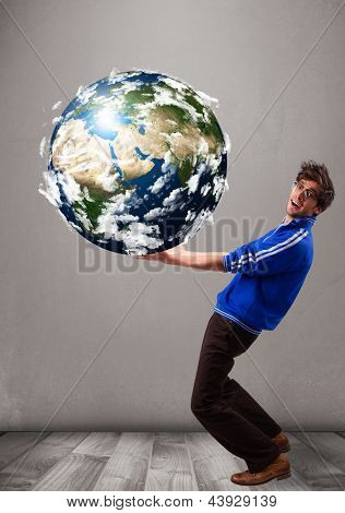 Good-looking young man holding 3d planet earth elements of this image furnished by NASA