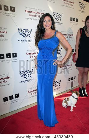LOS ANGELES - MAR 23:  Lisa Guerrero arrives at the 2013 Genesis Awards Benefit Gala at the Beverly Hilton Hotel on March 23, 2013 in Beverly Hills, CA